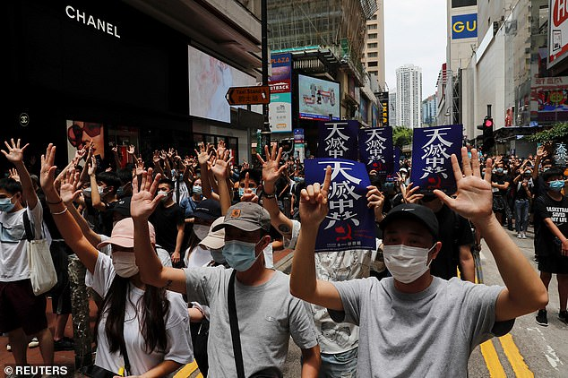 Anti-government protesters march again Beijing's plans to impose national security legislation in Hong Kong in May last year