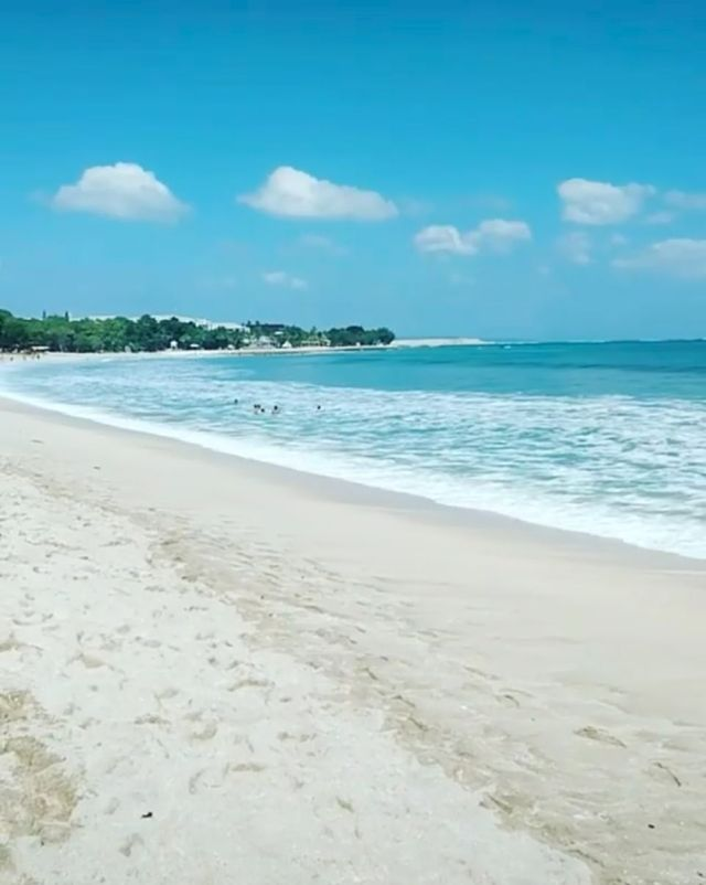 Kuta Beach (pictured) is rubbish-free for nine months of the year, until the monsoon season hits in December (pictured, the clean beach in September)