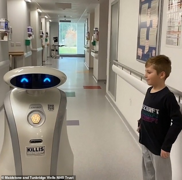 She left young patient Jimmy Edwards (pictured), nine, with a big grin after cracking the joke: 'How do trees access the internet? They log on'