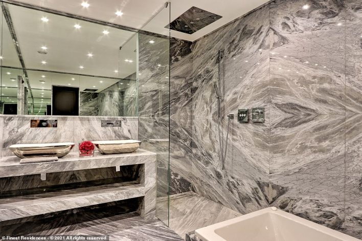 The bathrooms are decorated in luxury grey marble. The listing adds: 'The exceptional character of this luxury property in Les Parcs de Saint-Tropez, built in one of the most perfect locations of this ultra-exclusive domain, makes it a solid real estate investment'