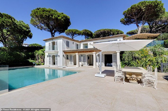 A luxury villa in theultra-prestigious Les Parcs de Saint-Tropez enclave, which has hit the market. Price is 'on application', but properties such as this usually sell for between 20 and 25million euros, according to the agent listing the house