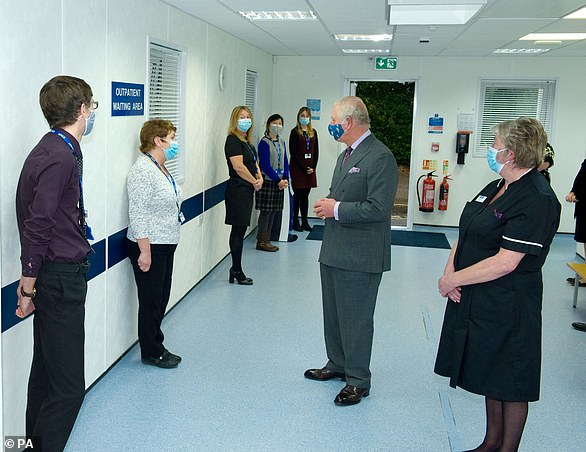 The Prince of Wales, pictured at Tetbury Hospital in December 2020, said delayed operations over the last year are causing 'despair'