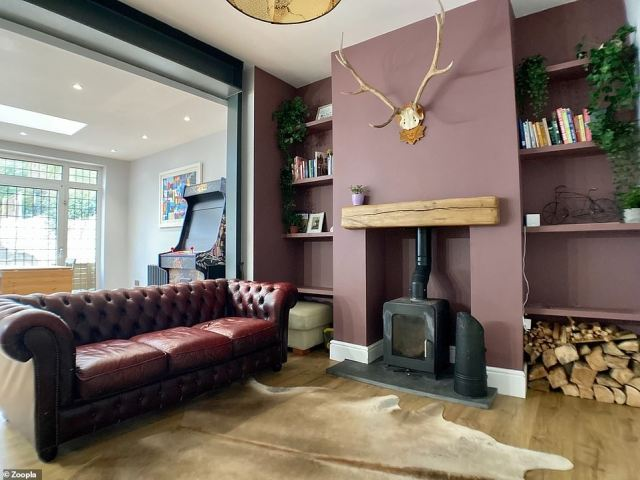 Keeping warm: There is a seating area focused around a wood burner with a feature beam and a slate hearth