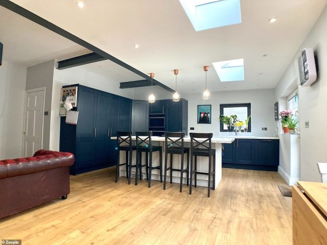 The house in Wales has recently been renovated and includes a contemporary kitchen with a central island