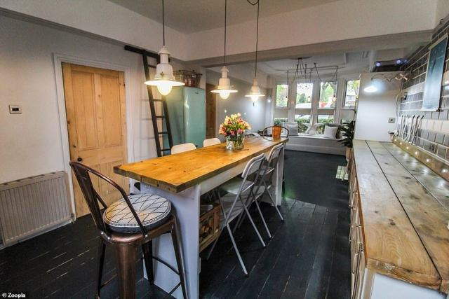 A family home: The semi-detached house has a long kitchen area with a large seating area in the centre