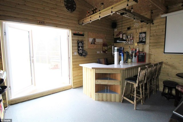 The perfect man cave? There is also a bar with seating in the outbuilding of the bungalow in Staffordshire