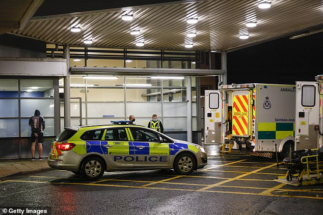 Dozens of police cars and ambulances from other hospitals rushed to the scene following reports of a nurse being stabbed in the grounds of the hospital