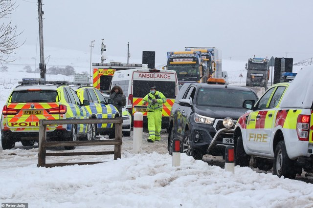 Emergency services at the Aultguish Inn on the A835 in the Highlands today after people were trapped in vehicles on Friday