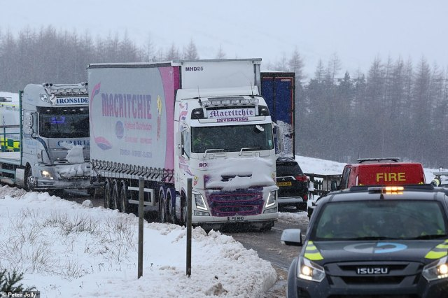 Some of the vehicles which were been trapped overnight on the A835 in the Highlands as they finally make it to safety Friday