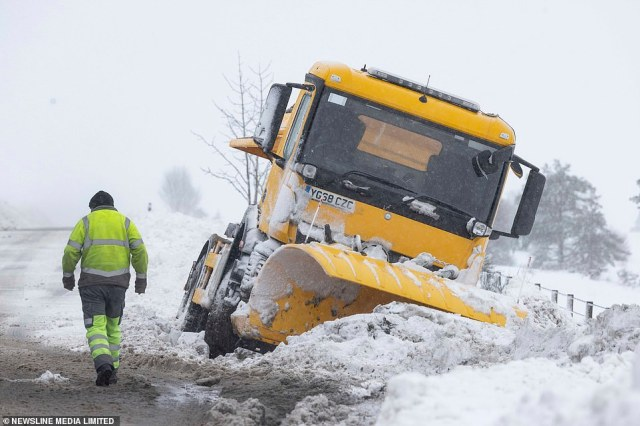 A snowplough is awaiting recovery Friday after coming off the A920 Huntly to Dufftown Road in the Highlands in the snow