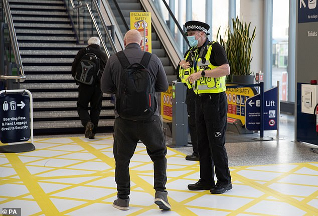 Despite the hotel scheme being discussed three weeks ago, it is still not yet in place but Foreign Office minister James Cleverly insisted it was taking 'time to prepare'. Pictured: An officer stops a passenger at Bristol Airport