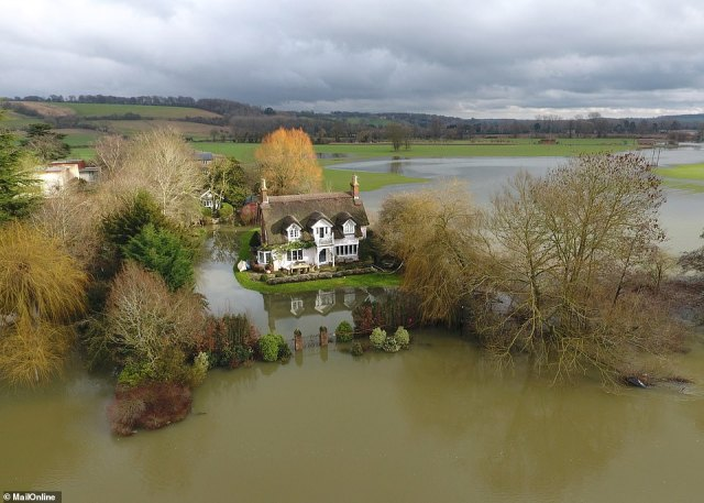 Brand's home looks to be in danger of being deluged after the River Thames burst its banks in parts of Berkshire