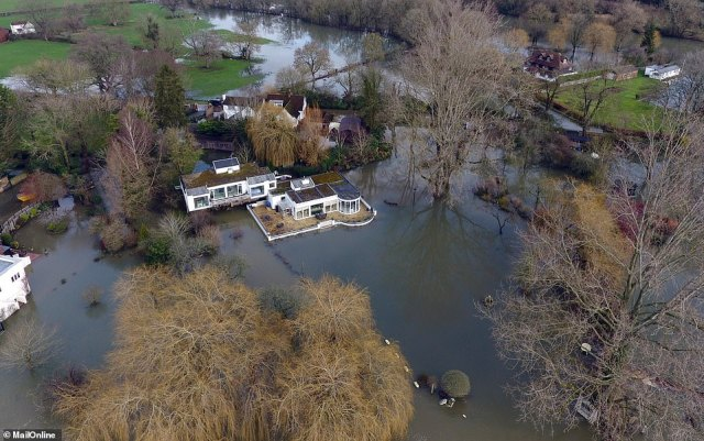 Debbie McGee's home on the River Thames in Berkshire is among the properties under major threat of flooding