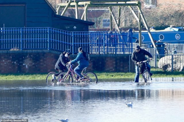 There are 139 flood alerts - where flooding is possible - and 36 flood warnings - where flooding is expected - still in place in England this morning. The areas expected to be hit include swathes of the River Thames and the River Severn, alongside the River Ouse at York. Pictured: Reading, Berkshire
