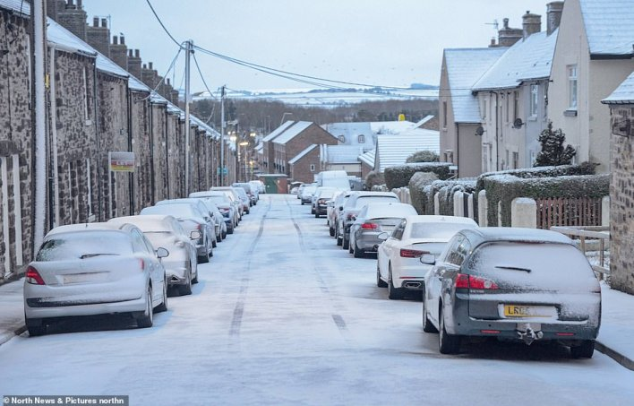 Snow covered cars in Consett, County Durham this morning after overnight snowfall in the wake of Storm Darcy