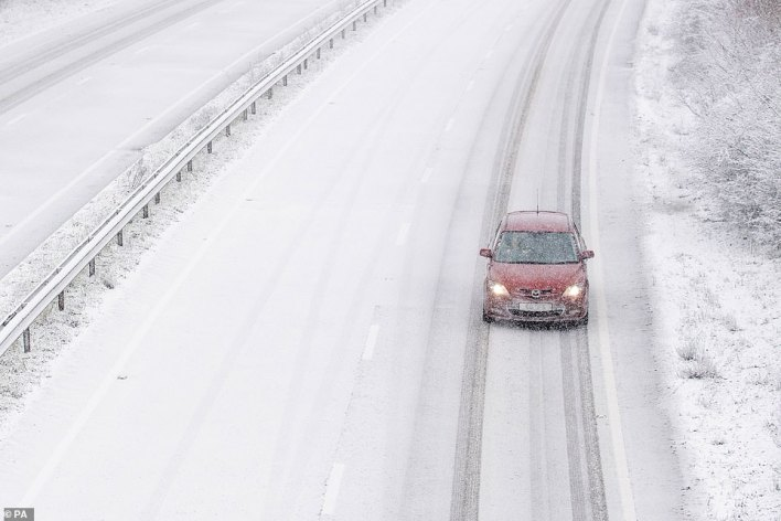 Snow falls on the A14 near Ipswich in Suffolk, with heavy snow set to bring disruption to South East England and East Anglia