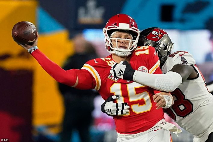 Patrick Mahomes absorbs a hit from Buccaneers outside linebacker Shaquil Barrett during the first half of Super Bowl LV