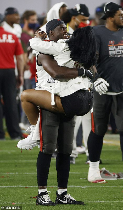 Tampa Bay Buccaneers' Lavonte David celebrates with loved ones