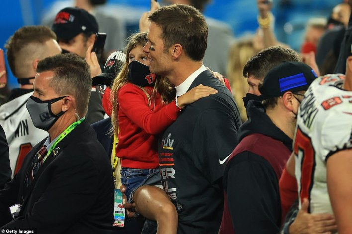 Tom Brady #12 of the Tampa Bay Buccaneers celebrates with his daughter Vivian Brady after defeating the Kansas City Chiefs