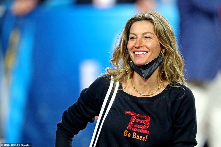 Gisele Bundchen waits for husband Tom Brady in one of his branded shirts following Super Bowl LV in Tampa on Sunday