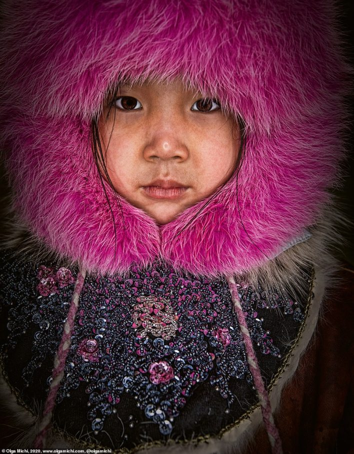 Pictured is a young girl from the Chukchi people. According to Michi, Chukchi could be aptly translated into English as 'genuine people'. This indigenous group, which has about 15,000 members, lives in the extreme northeast of Russia