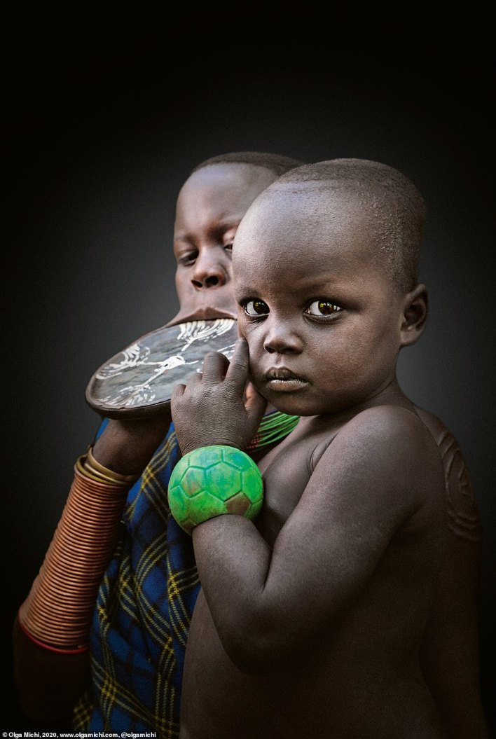 In the culture of the Mursi, an ethnic group in the Omo Valley of Ethiopia, jewellery is highly valued since it visibly reflects the talent, effort, and creativity of the wearer. The insertion of the lip plate is a rite of passage. The size of the plate is said to determine the bride price upon marriage