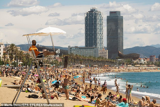 Millions of Britons have already booked holidays (pictured, Barcelona last year) ahead of the Prime Minister's announcement of the country's plan for easing restrictions on February 22 and Matt Hancock has previously predicted a 'Great British Summer'