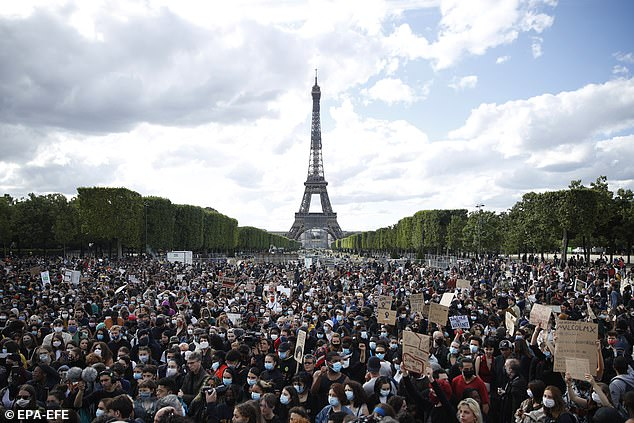 People demonstrate in support of the George Floyd protests in Paris in June