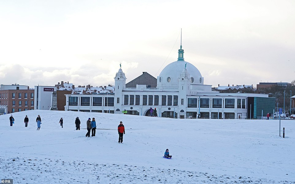 Early morning walkers and families out enjoying some sledging atWhitley Bay today