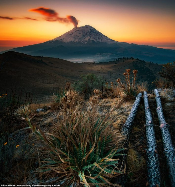 This jaw-dropping photo, called First Breath, shows Mexico's active Popocatépetl volcano. It was snapped at sunrise by Brian Mena Laureano, the winner of the national award for Mexico