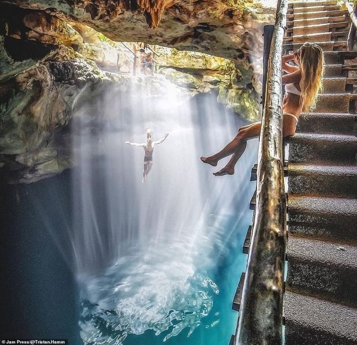 Los Angeles-based Tristan shares his own experienceswith a community of over one million followers across social media. He's pictured here leaping into a Cenote hidden deep in the Yucatan jungle in Tulum, Mexico