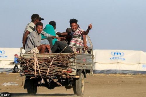 Ethiopian refugees who fled the Tigray conflict arrive at the Tenedba camp in Mafaza, eastern Sudan on January 8