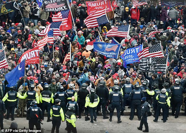 Trump supporters clash with police and security forces as they storm the US Capitol in Washington, DC on January 6 (file photo)
