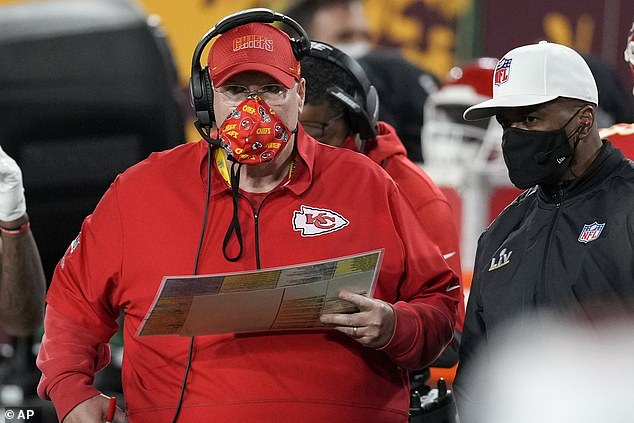 Kansas City Chiefs head coach Andy Reid, left, watches from the sideline during the first half of the NFL Super Bowl on Sunday