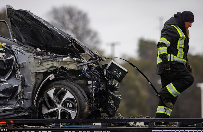The scene appeared almost too much to bear for one rescue worker as he walked away from a destroyed vehicle