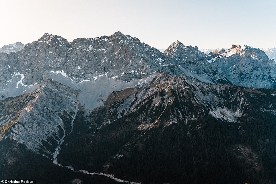 Christine says that the contrast between lush fields and tall, rocky summits in the German landscape is 'really spectacular'. Pictured is an epic part of the Karwendel Mountains. The highest peak in this range is the Birkkarspitze (9.019ft/2,749m) - located across the border in Austria