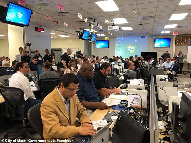 Miami is looking into offering the option for its 3,500 employees to receive their paychecks in cryptocurrency Bitcoin. Pictured, the City of Miami Emergency Operations Center