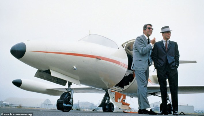 Dean Martin and Frank Sinatra outside of Sinatra's Learjet in the mid-60s.Sinatra became an early adopter of the private jet in 1965 as he took delivery of a Learjet 23 that he named Christina II, after his youngest daughter