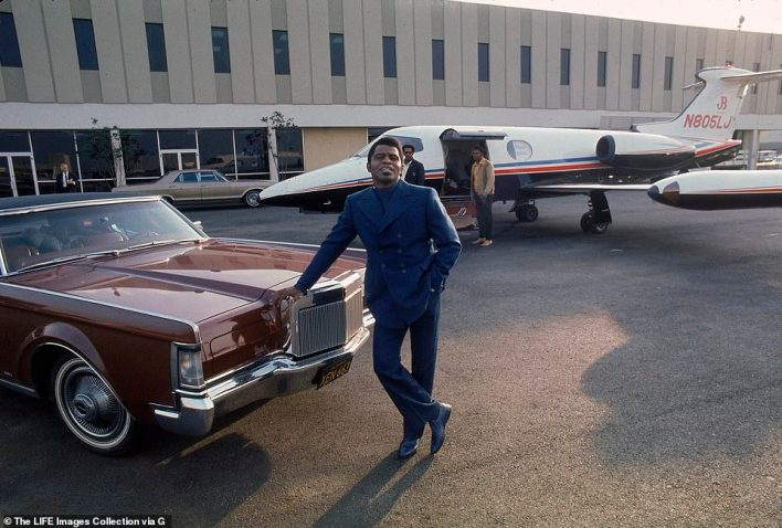 Singer James Brown at Los Angeles International Airport with his Lincoln Continental and a waiting Learjet