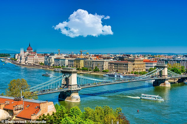 Titan Travel is offering an eight-day cruise along the Danube with full board from £1,699pp in August. Pictured is the Danube flowing through Budapest