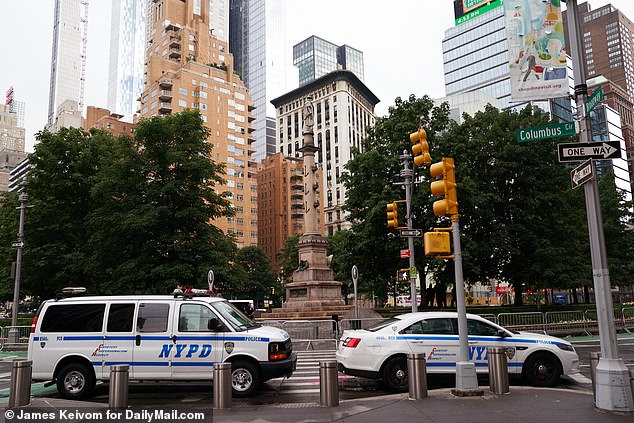 Cops have been guarding the statues across the city since at least June. NYPD cars around the Columbus Circle monument in June