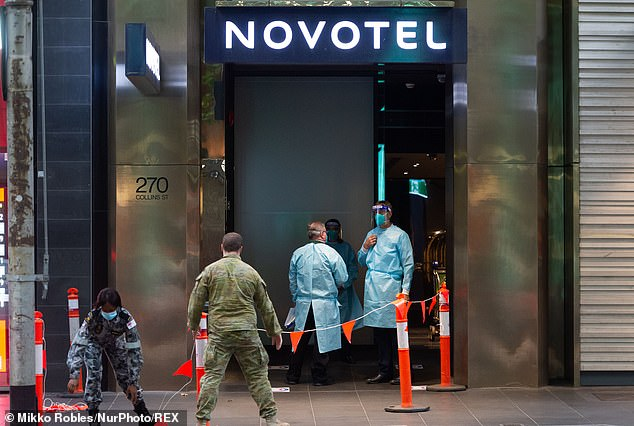Quarantine staff and soldiers prepare to welcome international travellers for quarantine at the Novotel Melbourne on Saturday