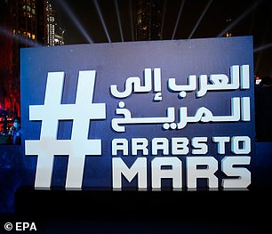People celebrated the arrival of the Hope Probe to Mars at Burj Plaza, in front of the world's tallest building, Burj Khalifa, in the Gulf emirate of Dubai, United Arab Emirates