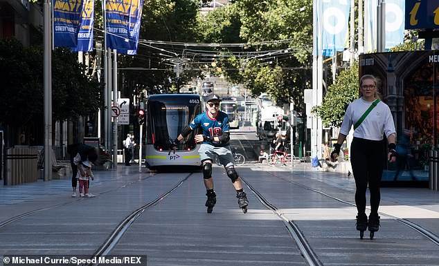 A roller bladder takes advantage of the city's deserted streets on the first day of the five-day snap lockdown on Saturday