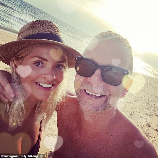 Happy couple: Earlier this month, Holly shared a rare glimpse inside her private life, when she shared a throwback selfie of her and husband Dan Baldwin to mark Valentine's Day