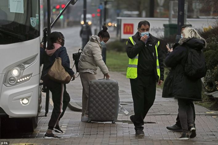 A coach delivers passengers to the Radisson Blu Edwardian Hotel, near Heathrow Airport, where they will have to go into ten-day quarantine