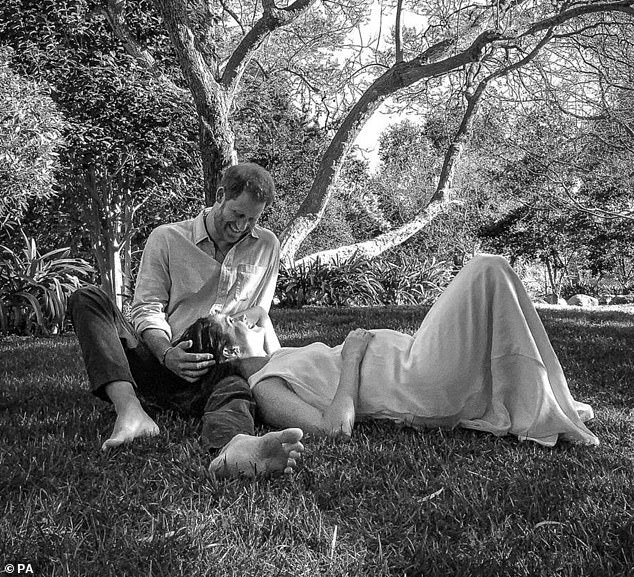 The black and white portrait showing the pair reclining under a tree on in Los Angeles was taken remotely from London using an iPad
