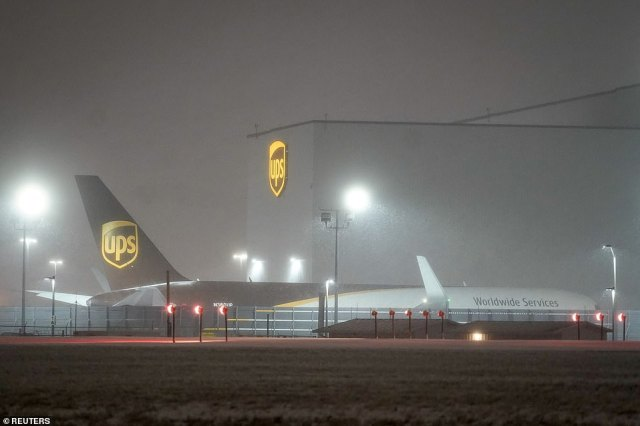 KENTUCKY:Snow falls at the United Parcel Service (UPS) WorldPort hub located at Louisville Muhammad Ali International Airport in Louisville