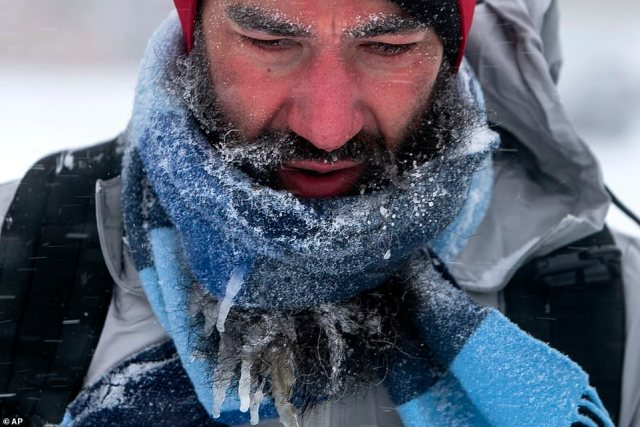 MISSOURI:Icicles hang from Jeffery Hemmer's beard as he walks the 26th mile of his 40 mile rucking journey near his home in Fairview