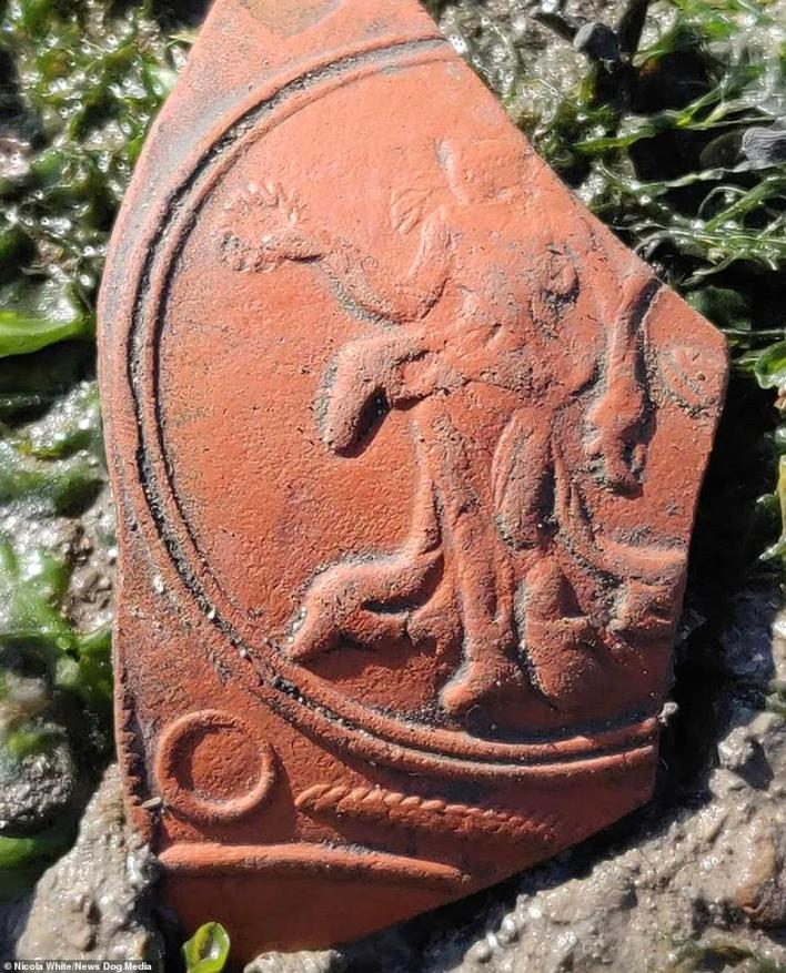 A piece of Roman pottery, known as Samian ware, which was made in the Roman Empire's North African and Eastern provinces. It will have been used for serving food, this one features the goddess Nike and was found by Nicola White in the River Thames, London